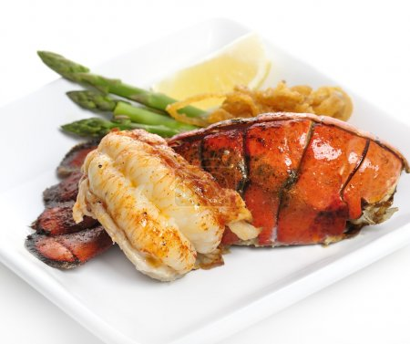 Photo for Grilled Lobster Tail Served With Asparagus And Onion - Royalty Free Image