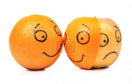 Photo for Apple and Orange emotions on white background - Royalty Free Image