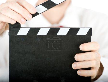 Businessman with a film slate