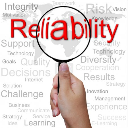 Reliability, word in Magnifying glass ,business background