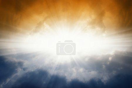 Bright sun in dark sky