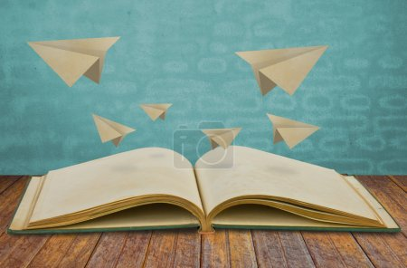 Photo for Magic book with paper plane - Royalty Free Image