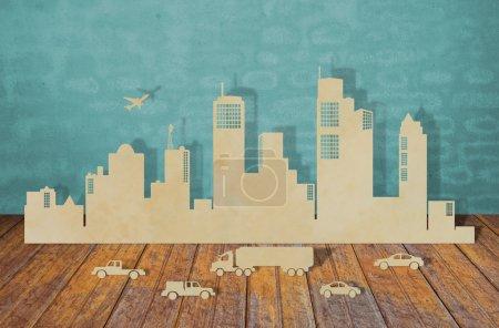 Photo pour Découpe de papier des villes avec voiture et avion - image libre de droit