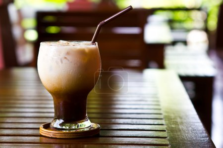 Photo for Ice cold coffee on a wooden table - Royalty Free Image