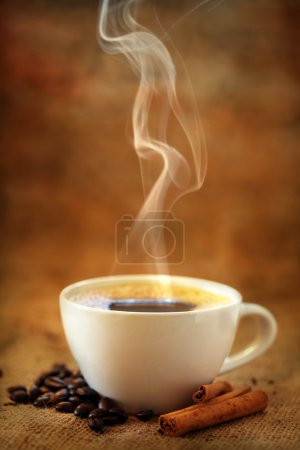 Photo for Coffee cup with coffee beans and cinnamon - Royalty Free Image