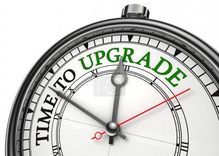 Photo pour Temps d'améliorer le concept horloge closeup isolé sur fond blanc avec les mots rouges et noirs - image libre de droit