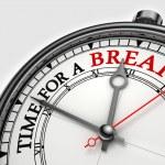Time fora break concept clock closeup on white bac...