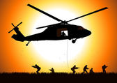 Silhouette illustration of helicopter dropping the troops