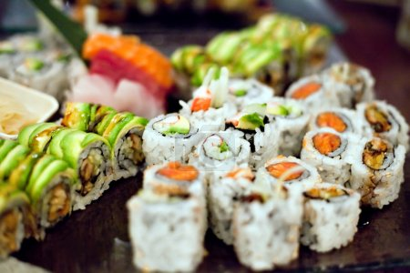 Photo for Variety of authentic sushi rolls on a platter. Shallow depth of field. - Royalty Free Image