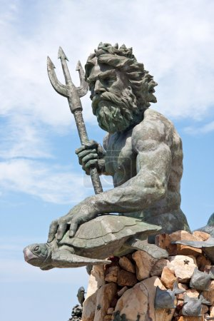 A large public statue of King Neptune that welcome...