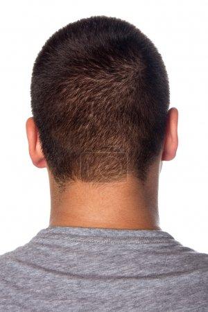Photo pour Un gros plan de l'arrière d'un jeune mans cervicofaciale isolé sur fond blanc. - image libre de droit