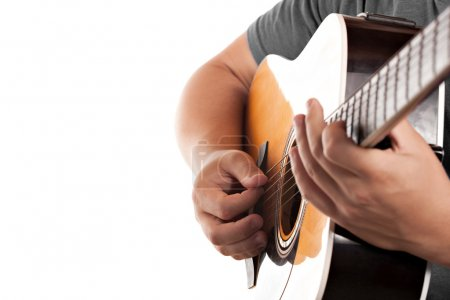 Photo for Closeup of a mans hands strumming and electric acoustic guitar isolated over a white background. - Royalty Free Image