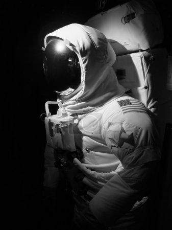 An astronaut set up under dramatic lighting - black and white.