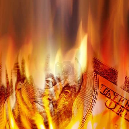 Burning American money with Benjamin Franklins fac...