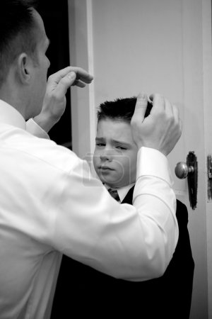 Father Helping Son Get Ready