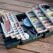 A large fishermans tackle box fully stocked with l...