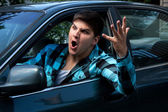 člověk vyjadřuje silniční vztek