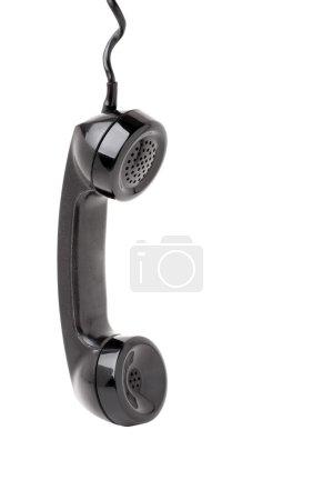 Foto de Cerca de un viejo teléfono vintage colgando de la cuerda aislada sobre un fondo blanco. - Imagen libre de derechos