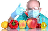 Scientist injecting GMO into the vegetables