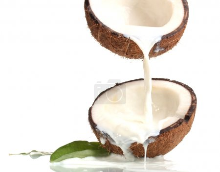 Coconut with coconut milk isolated on white