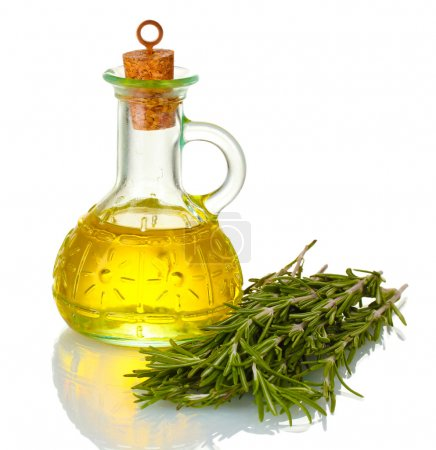 Photo for Oil in a bottle and fresh rosemary isolated on white - Royalty Free Image