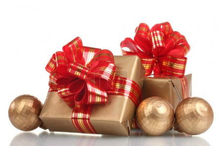 Beautiful golden gifts with red ribbon and Christmas balls isolated on white