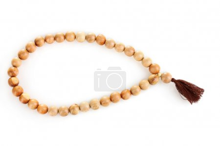 Wooden rosary isolated on white