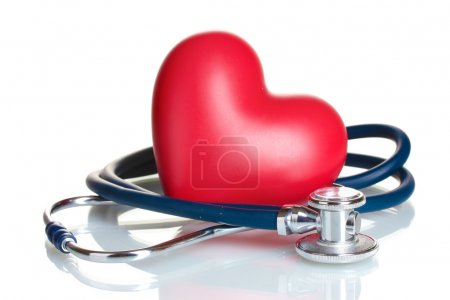 Medical stethoscope and heart isolated on white