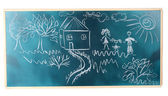 Blackboard with drawing happy family with house isolated on white