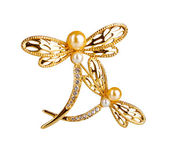 Beautiful golden brooch with precious stones isolated on white