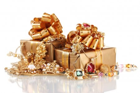 Various gold jewellery and gifts isolated on white