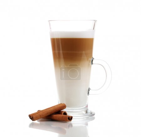 Fragrant сoffee latte in glass cup and cinnamon isolated on white
