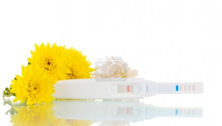 Pregnancy test and flowers isolated on white