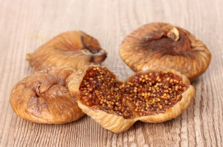 Delicious dried figs on wooden background