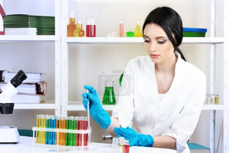 Young female scientist working in chemical laboratory