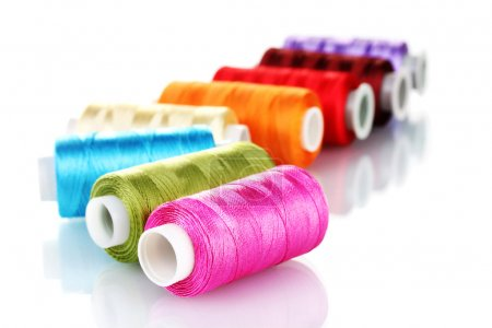 Bright bobbin thread isolated on white