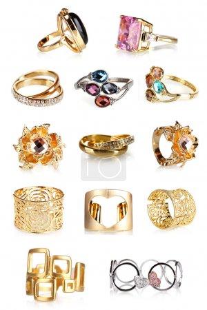 Foto de Hermosos anillos de oro y pulseras colección aislada en blanco - Imagen libre de derechos