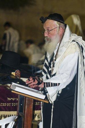 Jewish old man prays during the penitential prayer...