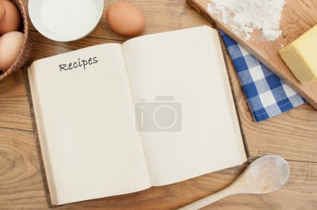 Photo for Open blank recipe book surrounded with ingredients - Royalty Free Image