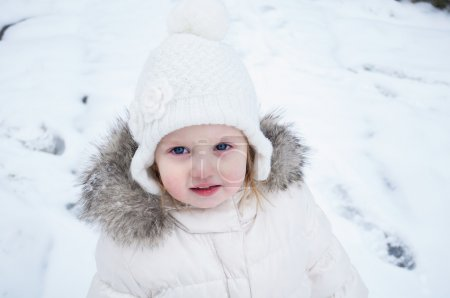A cute baby girl in snowsuit