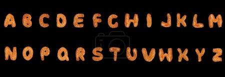 Photo pour Lettres de l'alphabet Britannique fait de pain d'épices sur fond noir - image libre de droit