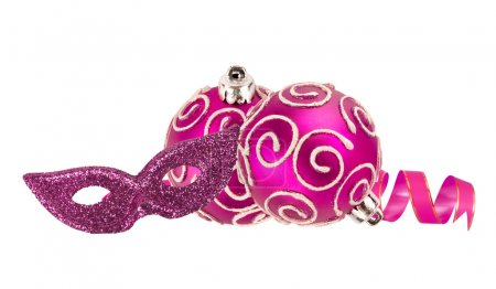 Beautiful pink Christmas balls and carnival mask isolated on whi