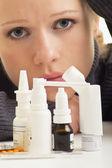 Young woman having flu takes pills