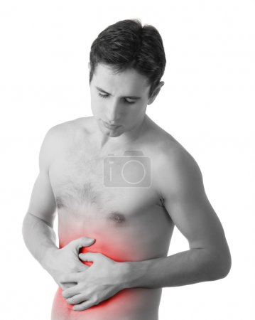 Young man holding his sick stomach in pain, isolated on white ba