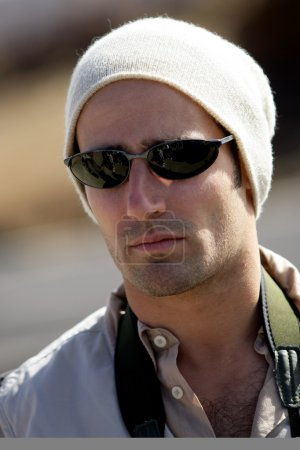 Man in sunglasses and beanie hat