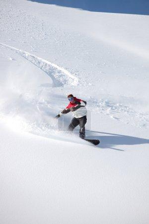Man snowboarding on isolated piste