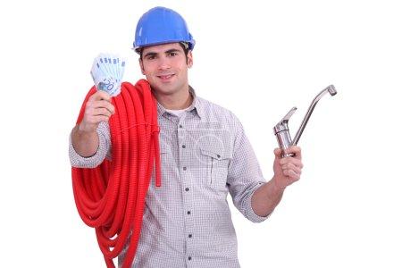 Plumber showing bills