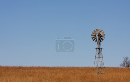 Photo for Lonely Windmill on the Plains of Northern Oklahoma - Royalty Free Image