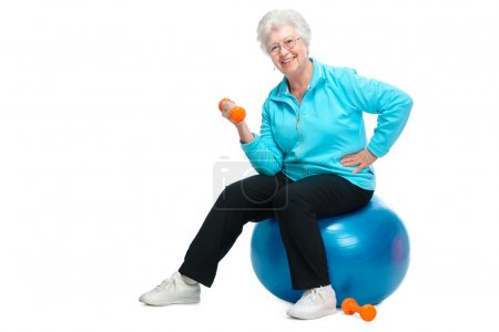 Photo for Happy senior woman making fitness training with dumbbells - Royalty Free Image