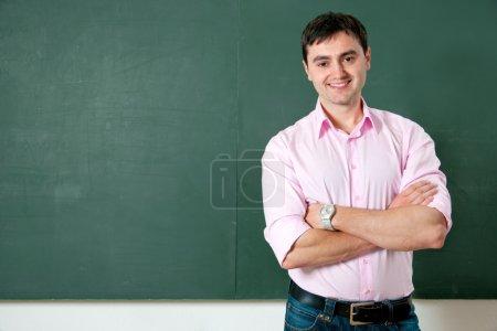 Student or teacher at the blackboard